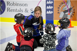Small groups of children are introduced to skating by highly qualified instructors