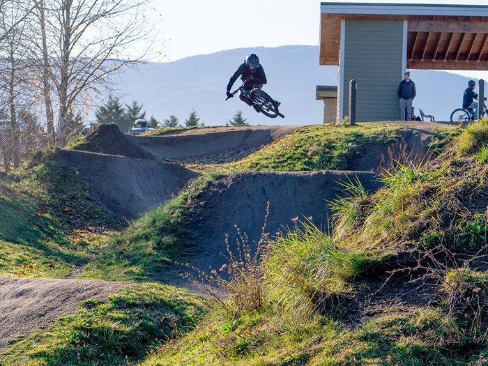 Cyclist jumping on a downhill run at the Steve Smith Bike Park