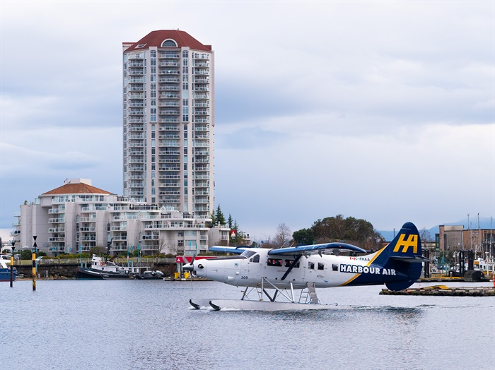 A Harbour Air seaplane is moving out to the open water for takeoff