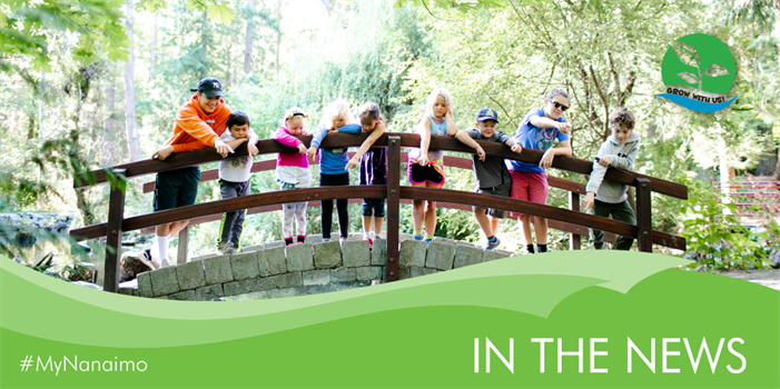 In the news header image of kids on bridge in Bowen Park